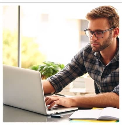 Telecommuting Worker with Laptop