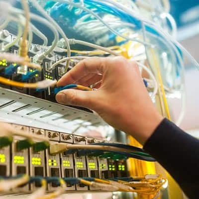 Hand plugging in network cables