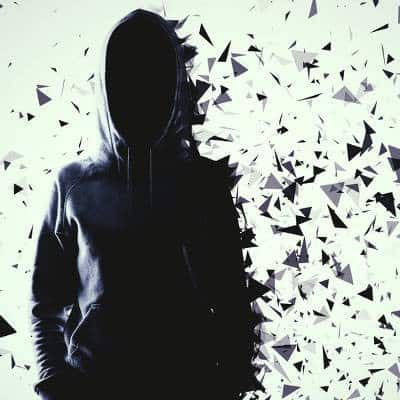Silhouette of a person in a hooded sweatshirt