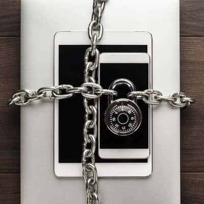 Padlock and chain wrapped around mobile devices