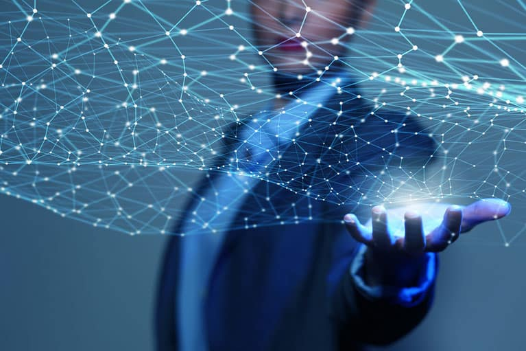 Businesswoman Holding Holographic Web of Nodes
